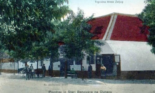 Na staroj razglednici s prve polovine 20. veka vidi se mesto Stari Banovci na Dunavu i trgovačka radnja Alekse Zeljuga iz Starih Banovaca.